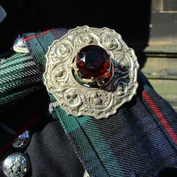 What does a bagpiper wear plaid brooch